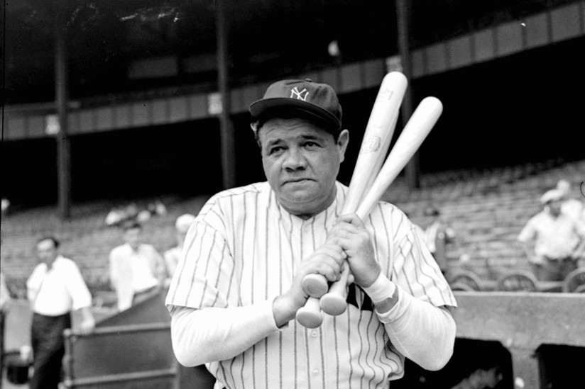 Retired Yankees slugger Babe Ruth warms up with three bats before stepping to the plate at New York's Yankee Stadium, August 21, 1942, as he prepared for a hitting exhibition at the stadium two days later against retired pitching great Walter Johnson. The pair faced off between games of a doubleheader between the Yankees and the Washington Senators for the benefit of Army and Navy Relief Funds. (AP Photo/Tom Sande)