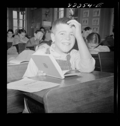 Boy at Desk Smiling Photograph