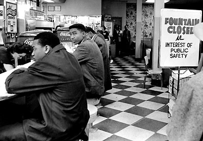 60civilrights04...Negro students sit as a closed sign went up immediately when they attempted to get served at the lunch counter of Walgreen's drugstore on Fifth Ave. and Arcade Downtown Nashville. Luther Harris, Fisk student who acted as spokesman for the group, said it was the first effort in the South to desegregate drugstore faclities. Staff photo by Jimmy Ellis (The Tennessean) 2/20/1960