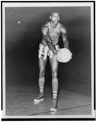 Wilt Chamberlain, full-length portrait, wearing uniform of Harlem Globetrotter's basketball team