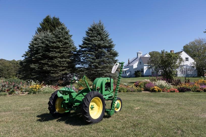 Tractor, flowers, and farmhouse near Brunswick, Maine.