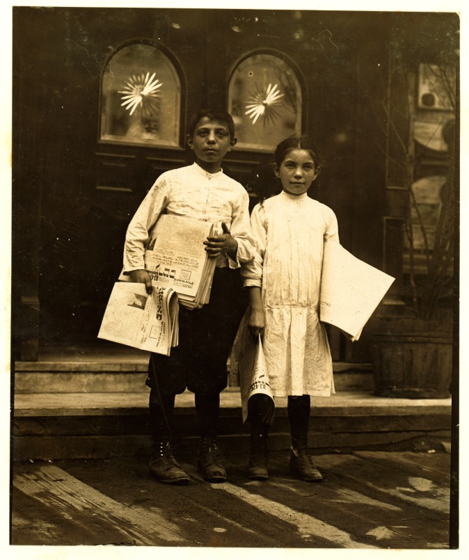 Lewis_Hine,_Newsgirl_and_boy_selling_around_saloon_entrances,_Bowery,_New_York,_1910